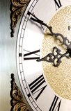 Ten till Nine. Hands of a grandmothers clock showing the time ten till nine Royalty Free Stock Image