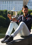 Ten times Grand Slam champion Novak Djokovic posing in Central Park with championship trophy Royalty Free Stock Photo