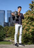 Ten times Grand Slam champion Novak Djokovic posing in Central Park with championship trophy Stock Photos