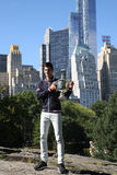 Ten times Grand Slam champion Novak Djokovic posing in Central Park with championship trophy Stock Photo
