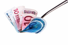 Ten and twenty euro banknotes on fork. Stock Images