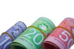 Canadian Dollars isolated on white background. Ten, Twenty and Fifty Canadian Dollars roll isolated on white background Royalty Free Stock Images