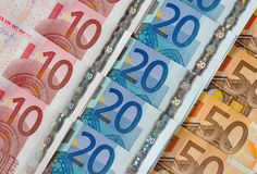 Ten, twenty and fifty euro notes diagonal rows. Royalty Free Stock Photography