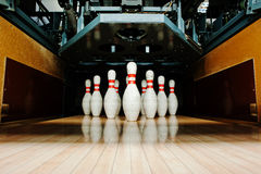Ten white pins in a bowling alley lane Stock Photos