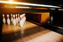 Ten white pins in a bowling alley lane Royalty Free Stock Photo