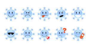 Ten winter smilies Stock Photos