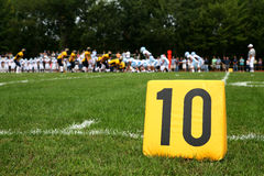 Ten Yard Line Marker. A yellow ten yard line marker at a football game Royalty Free Stock Photography