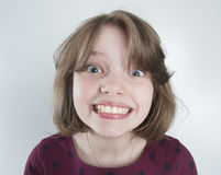 Ten-year girl with a funny smile. 