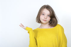 Ten-year girl showing hand side. Royalty Free Stock Photos