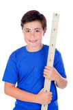 Ten year old boy with a meter of wood Royalty Free Stock Photos