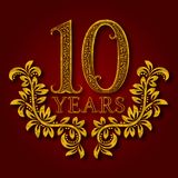 Ten years anniversary celebration patterned logotype. 10th anniversary vintage golden logo. With shadow Royalty Free Stock Images