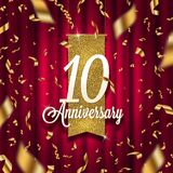 Ten years anniversary golden signboard in spotlight on red curtain background and golden confetti. Stock Photo