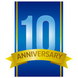 Ten years anniversary label. Light blue digits 10 on navy blue background and gold ribbon below. Vector design element stock photography