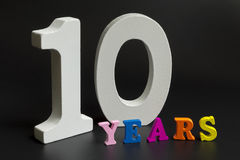 Ten years. Figures and year on a black background Royalty Free Stock Images