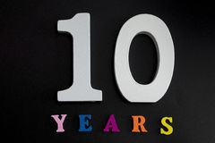 Ten years. Figures and year on a black background Royalty Free Stock Photography