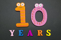 Ten years. Figures and year on a black background Stock Image