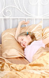 Ten years' girl has woken up Royalty Free Stock Photo