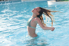 Ten years girl in pool Stock Images
