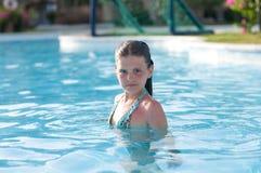 Ten years girl in pool Royalty Free Stock Image