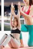 Ten years girl strething at fitness class Stock Photo