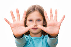 Ten years. Little girl with long hair shows her ten fingers Royalty Free Stock Photos