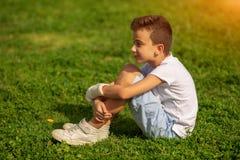 Ten years Old Child Keeps Broken Arm in Gypsum royalty free stock photos