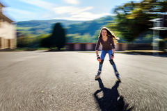 Tenage girl rollering. Quick moving. Tenage girl rollering. Sunny day. Quick moving Royalty Free Stock Photos