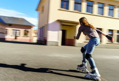 Tenage girl rollering. Quick moving. Tenage girl rollering. Sunny day. Quick moving Stock Photography