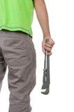 Tenager hält eine Trompetetaste an Lizenzfreie Stockfotografie