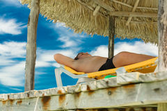 Tenager resting on the pier Stock Image