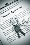 Tenancy agreement. And key with symbolic house keyring Royalty Free Stock Photography