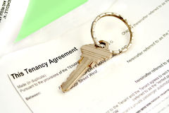 Tenant agreement. Tenancy agreement with key for lease and housing Stock Photography