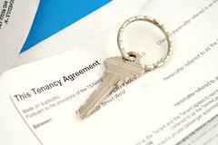 Tenant agreement. Some paperwork concerning tenancy agreement with key Royalty Free Stock Photos