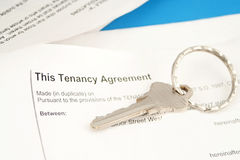 Tenant agreement. Some paperwork concerning tenancy agreement with key Royalty Free Stock Images