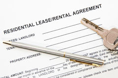 Tenant agreement concept. Rental agreement printed on paper with gold pen and keys lying on it Royalty Free Stock Photography