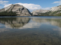 Tenaya lake. And surrounding peaks and domes reflected in it with an emphasis on the lake with copy space at the bottom Stock Photography