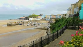 Tenby Welsh: Dinbych-y-pysgod, meaning fortlet of the fish is a walled seaside town in Pembrokeshire, Wales,. Notable features Stock Photo