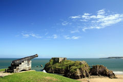 Tenby cannon. Old Tenby's cannons pointing to Saint Catherine Island Stock Images