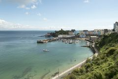 Tenby, Pembrokeshire, South Wales. Tenby, coastal town in Pembrokeshire South Wales. View of boats in the harbour in August showing a blue sky royalty free stock image