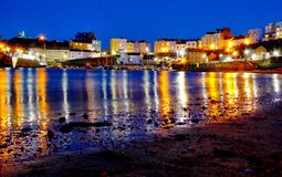 Tenby Harbour. Tenby Habour and North Beach at Night with reflected lights Stock Images