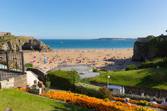 Tenby Pembrokeshire Wales uk castle beach in summer with tourists and visitors and blue sky Stock Images