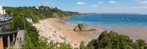 Tenby Pembrokeshire Wales uk north beach in summer with tourists and visitors and blue sky Stock Image