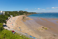Tenby Pembrokeshire Wales uk north beach in summer with tourists and visitors and blue sky Stock Photos