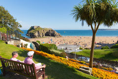 Tenby South Wales castle beach in summer with tourists and visitors and blue sky Stock Photos