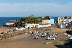 Tenby South Wales Uk In Summer With Tourists And Visitors And Blue Sky And Boats In Harbour Stock Photos