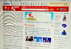 Tencent QQ chinese website. Tencent QQ, generally referred to as QQ, is the most popular free instant messaging computer program in Mainland China.  Since its Stock Images