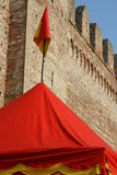 Tend yellow and red lines at the foot of the old castle walls Royalty Free Stock Photography