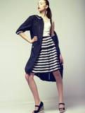 Tendency. Beautiful Fashion Model in Outwear. Elegance. Fashionable female posing in studio. Elegance Stock Photography
