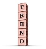 Tendenz-Wort-Zeichen Vertikaler Stapel von Rose Gold Metallic Toy Blocks Lizenzfreie Stockfotografie