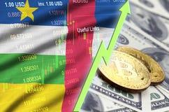 Tendenza crescente della bandiera e di cryptocurrency della Repubblica centroafricana con due bitcoins sulle banconote in dollari illustrazione di stock